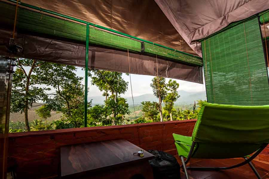 Relaxing-chair-with-a-beautiful-view-at-Night-view-of-Luxury Tent Stay At Pozuthana