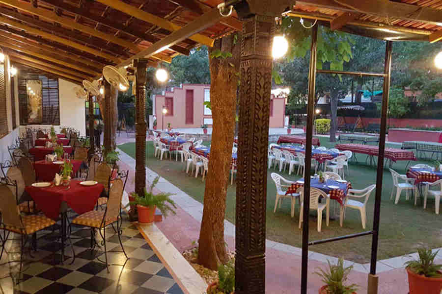 Outdoor seating at Exotic Resort Near Fateh Sagar Lake