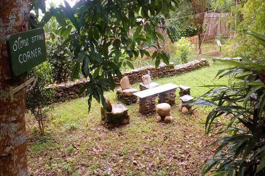 Stone seats at the Serene Retreat In Kalimpong