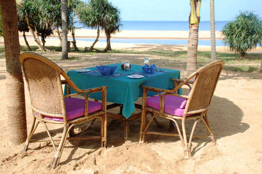 Dining on the beach at the Tranquil Hideaway At Nileshwar