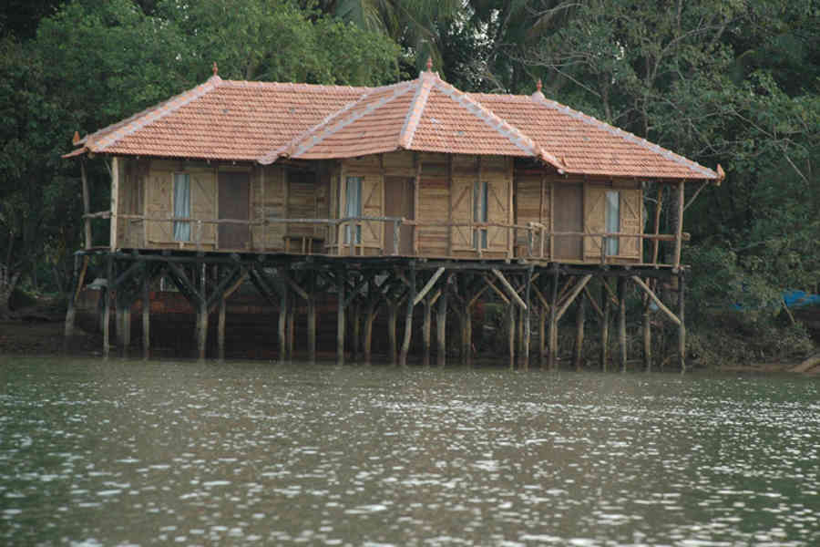 Stilt huts at the Island Stay In Kundapur