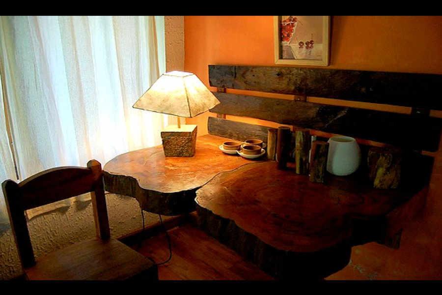 Handcrafted table at Plantation Home At Pothamedu