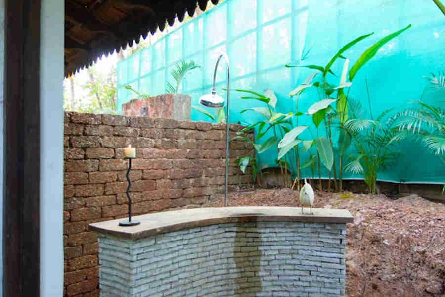 Outside shower in the Caraway Room at Colonial Portuguese Bungalow At Moira