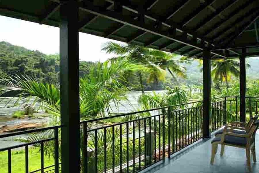 Verandah at Hillside Resort Near Athirapilly Waterfalls
